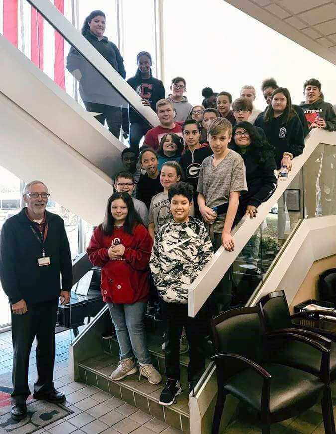 Don Gregg hosting a group of middle school students for a STEM visit at Roper Corporation
