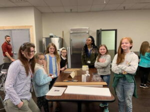 Students completing hands on activites during STEM visit to Roper